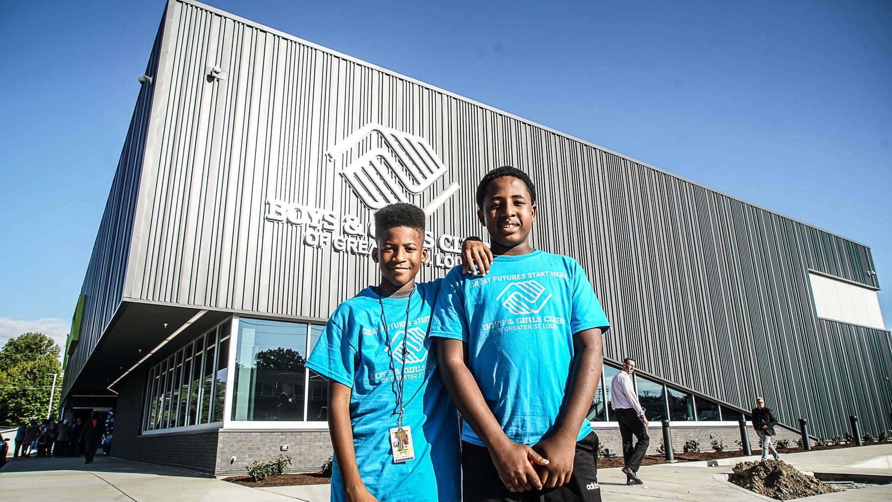 two boys standing in front of new building